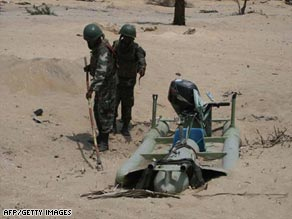 Sri Lanka's defense ministry says this handout photo shows troops with a captured Tamil Tiger craft Thursday.