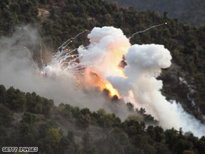 U.S. mortars using white phosphorous target Taliban in Afghanistan's Korengal Valley, October 28, 2008.