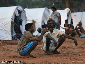 Displaced Tamil civilians at Manic farm in the northern Sri Lankan district of Vavuniya on May 7, 2009