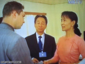A television grab shows Aung San Suu Kyi meeting with diplomats at Insein Prison in Yangon on May 20.