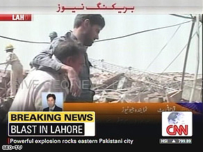 An injured man is helped at the site of the blast.