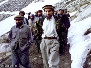 Ahmad Shah Massoud, center in white shirt, leads his men in his beloved Afghan mountains.