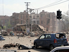 The scene of an apparent suicide car bomb attack on a police building in Lahore on May 27.