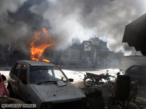 Smoke billows from a fire at the site of a marketplace bomb in Peshawar, Pakistan, last week.