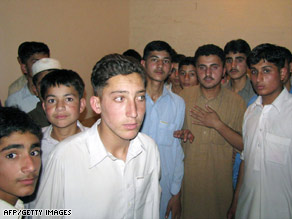 Pakistani students arrive safely in Bannu on Monday after militants abducted their colleagues.