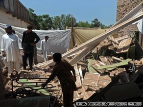 Residents sift through the rubble of a bombed school near Peshawar.
