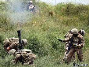 U.S. Marines fire a mortar Wednesday in Afghanistan's Helmand province, where they're fighting the Taliban.