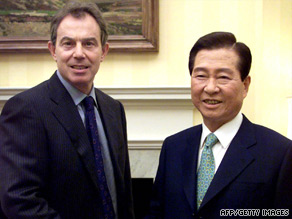 Kim (right) with former British Prime Minister Tony Blair in London in 2001.