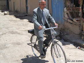 Presidential candidate Sangin Mohammed Rahmani out campaigning on his bicycle.