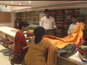Shubhangi Bhave, at left buying a sari, likes casualwear, a sign of changing tastes among Indian women.