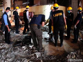 Police investigate the aftermath of a bomb blast at a restaurant in the Marriot hotel in Jakarta.