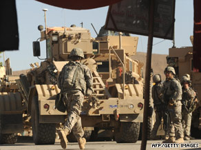 A U.S. soldier takes his position near a building attacked by the Taliban south of Kabul, Afghanistan, on Monday.