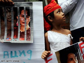 A young girl holds a portrait of Aung San Suu Kyi at a rally in Bangkok, Thailand, on Tuesday.