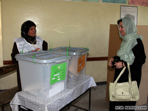 Afghan first lady Zenat Karzai votes for her husband and provincial council candidates in Kabul.