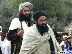 Baitullah Mehsud, right, former leader of the Pakistani Taliban, and a bodyguard in Pakistan, in 2004.