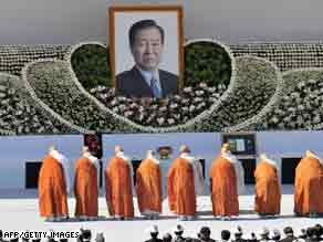 South Korean Buddhist monks pray in front of a portrait of former  president Kim Dae-jung during his funeral Sunday.