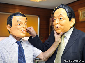 Rubber mask maker staff display masks of Prime Minister Taro Aso, left, and DPJ leader Yukio Hatoyama.