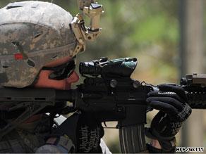 U.S. Staff Sergeant Robert Brunner secures an area in the Baraki Barak district of Logar Province on August 22.