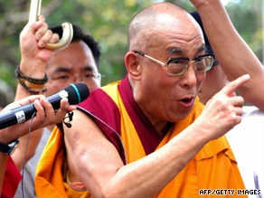 The Dalai Lama visits the typhoon-hit village of Hsiaolin, in Kaohsiung county, southern Taiwan on Monday.
