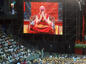 A screen shows the Dalai Lama praying at a ceremony in Kaohsiung, Taiwan, for typhoon victims Tuesday.