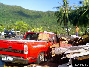 Debris clutters a road in Pago Pago, American Samoa, after a devastating earthquake and tsunami Tuesday.
