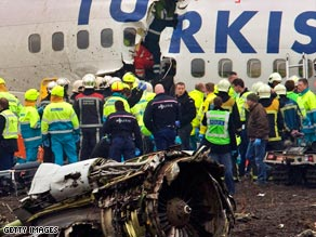 Rescuers attend the fuselage of the Turkish Airlines Boeing 737-800 following Wednesday's crash.
