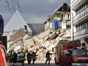 Rescuers are searching for people trapped under the building in Cologne, Germany.