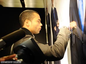Footballer Ashley Cole, pictured signing an autograph at a chairty event in London Wednesday.