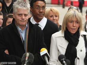 The parents of Robert Knox read a statement outside the Old Bailey after Karl Bishop was found guilty of his murder.