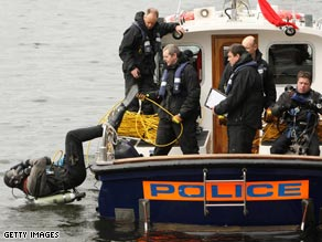 Police divers carry out security checks near the site of next week's G-20 summit in London.