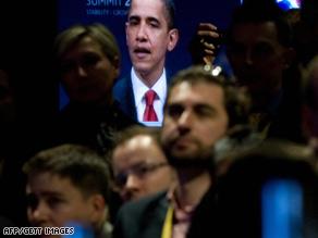 People in London watch U.S. President Barack Obama speak late Thursday following the G-20 summit.