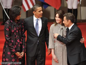The Obamas and the Sarkozys pose for photos Friday in Strasbourg.