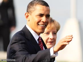 President Obama and German Chancellor Angela Merkel greet other leaders Saturday at the NATO summit.
