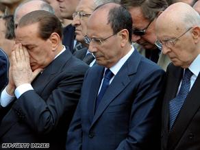 Berlusconi (left) alongside Senate leader Renato Schifani and Italian President Giorgio Napolitano at Friday's funeral.