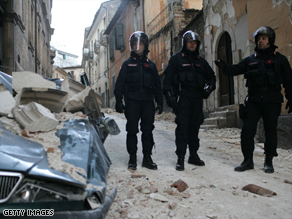 Italian police patrol the ruined streets of L'Aquila to prevent possible looting.