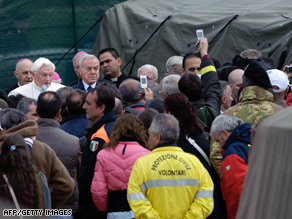 Pope Benedict XVI speaks to quake survivors at a tented camp in the village of Onna.