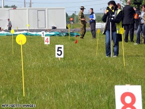 Australian soldiers and forensic experts work on the field in Fromelles, France, on Monday.