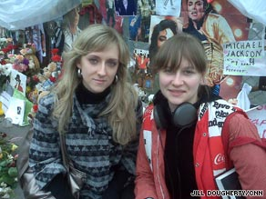 Alexandra Belayeva, left, and Zhenya Iordanskaya visit the Michael Jackson memorial in Moscow.