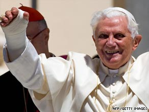 The pope celebrates mass with his broken wrist in plaster.