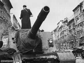 A Soviet tank rolls through Budapest during the failed 1956 Hungarian uprising against communist domination.
