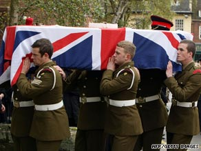 A casket containing the body of a British serviceman is carried at a ceremony in the UK.