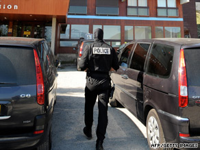 A French anti-terror police walks outside ski apartments where   three suspected ETA members were arrested Wednesday.