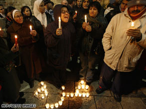 Palestinians hold a candlelight vigil Thursday night in east Jerusalem for their brethren in Gaza.