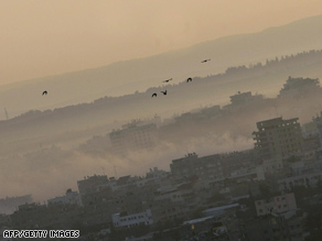 Smoke rises Saturday over Gaza City from artillery strikes.
