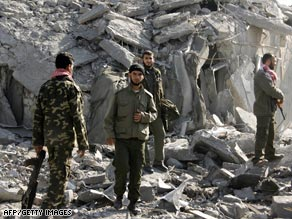 Members off the Hamas-affiliated Palestinian National Guard inspect their destroyed headquarters.