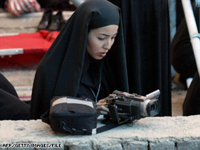 Journalist Roxana Saberi, shown working on the outskirts of Tehran in 2004, hasn't been heard from in a month.