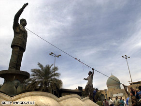An Iraqi crowd pulls down a statue of Saddam Hussein in Baghdad in April 2003.