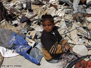 On March 6, a Palestinian boy sits on the rubble of a building destroyed during Israel's 22-day Gaza offensive.