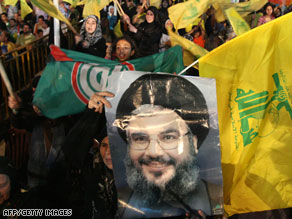 Hezbollah supporters at a Beirut rally holding a poster of leader Hassan Nasrallah.