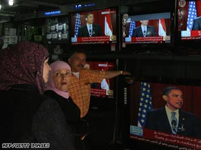 Palestinians in East Jerusalam watch President Obama's speech at an electronics shop.